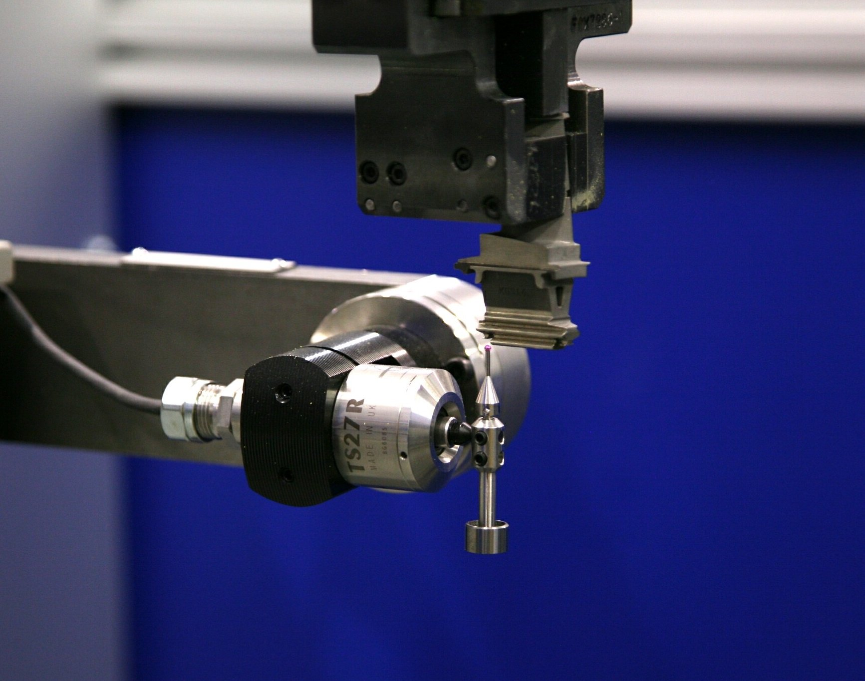 Acme Robot Measuring a Part with a Needle Probe